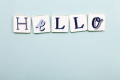 Hello signboard. Handwritten colors letters. Light blue background. Calligraphy and lettering fine art stock photography