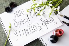 Hello spring calligraphy note. On white paper royalty free stock photo
