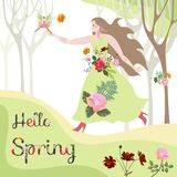 Hello Spring. Flower Fairy arrived to beautiful woman in floral dress.  Stock Photos