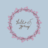 Hello Spring hand drawn lettering with sprout icon. Hello Spring hand drawn lettering with sacura wreath. Vector greeting card on a blue background Stock Image