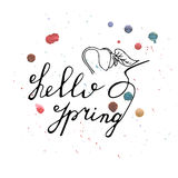 Hello Spring hand drawn lettering. With watercolor splashes Royalty Free Stock Image