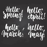 Hello, Spring, March, April, May - hand drawn lettering phrase on the black chalkboard background.Fun brush ink. Inscription for photo overlays, greeting card stock illustration