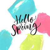 Hello Spring. Modern calligraphy text at colorful background with blue, pink and green acrylic paint strokes. Hello Spring. Modern calligraphy text at colorful Stock Photography