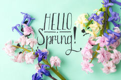 Hello spring note with hyacinth flowers. Hello spring calligraphy note with hyacinth flowers stock images