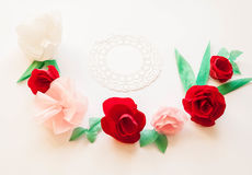 Hello, spring! Red paper flowers. Red  paper flowers on white background. Cut from paper. Place for your text Royalty Free Stock Images