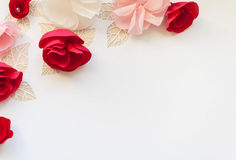 Hello, spring! Red paper flowers. Red  paper flowers on white background. Cut from paper. Place for your text Stock Photos