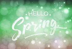 Hello Spring welcome sign. Vector typography in fresh colors for your design. Vintage lettering on blurred bokeh green background Stock Photo