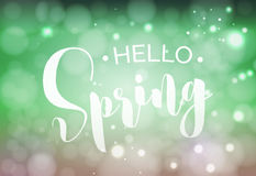 Hello Spring welcome sign. Vector typography in fresh colors for your design. Vintage lettering on blurred bokeh green background Stock Photography