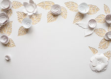 Hello, spring! White paper flowers. White paper flowers on white background. Cut from paper. Place for your text Stock Photo