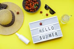 Hello Summer blocks background on the yellow table: Straw Hat, s Stock Images