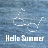 Hello Summer on blue jeans. Blurred background Stock Image