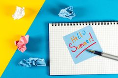 Hello Summer - inscription at notes on blue background. First summer day, Calendar concept.  royalty free stock photo