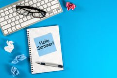Hello Summer - inscription at notes on blue office background. First summer day, Calendar concept. With copy space for. Text stock image