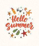 Hello Summer text with beach elements. Sunscreen, sunglasses, cocktail, starfish, flip flops. Royalty Free Stock Photos