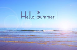 Hello Summer text over beautiful wide beach. Royalty Free Stock Photos