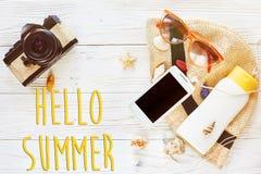 Hello summer text, travel vacation flat lay concept. photo camer Stock Photo