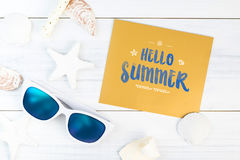Hello Summer word on gold paper card white Summer Beach accessor stock photo