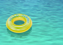 Hello summer written on the yellow swimming ring Royalty Free Stock Photo