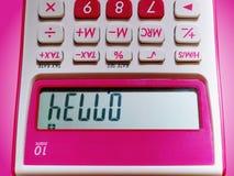 Hello text på LCD-skärm av den rosa visningen för räknemaskin 10-Digit upp sida ner royaltyfri bild