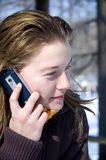 Hello there. Young girl talking on the phone royalty free stock images