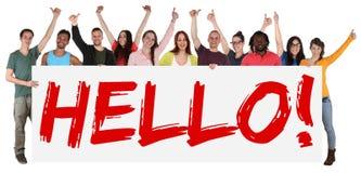 Hello undertecknar gruppen av det hållande banret för ungt mång- etniskt folk Arkivfoton