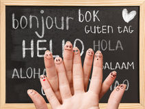 Hello in various languages on chalkboard. Hello in various languages on a black chalkboard royalty free stock photos