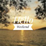 Hello Weekend greeting. With blurry sunset background royalty free stock photo