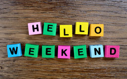 Hello Weekend on table. Hello Weekend on wooden table Stock Photography