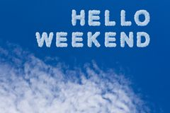 Hello weekend typography note on cloudy sky. Beautiful blue sky and cloud with Hello weekend word Stock Image