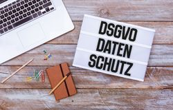 German General Data Protection Regulation DSGVO new law in 201. Hello 2018 welcome message in light box, grunge wood table flat lay shot from above royalty free stock photos