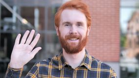 Hello, Welcoming Redhead Beard Young Man Standing Outdoor. 4k high quality, 4k high quality stock video footage