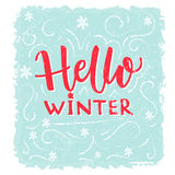 Hello winter banner. Text on frost texture blue background with hand drawn snowflakes. Vector winter greeting lettering Royalty Free Stock Photography
