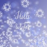 Hello Winter Lettering on Blue Sky Background Royalty Free Stock Photos