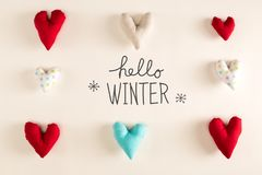 Hello Winter message with blue heart cushions stock images