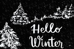 Hello Winter message on nature landscape with fir trees Stock Photos
