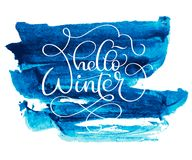 Hello winter text on blue abstract background with colorwater brush.   Royalty Free Stock Photo