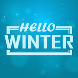 Hello winter text. Brush lettering at blue winter background with snowflakes and bokeh lights. Vector card design Royalty Free Stock Images