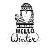 Hello winter text brush lettering and knitted woolen mitten with heart. Seasonal shopping concept design for the banner Stock Photos