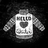 Hello winter text and knitted wool pullover with a heart. Seasonal shopping concept design for the banner or label. Royalty Free Stock Photography