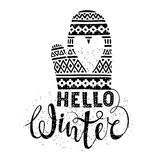 Hello winter text and knitted woolen mitten with heart. Seasonal shopping concept design for the banner or label. Royalty Free Stock Photography