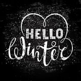 Hello winter text lettering with heart element. Seasonal shopping concept to design banners, price or label. Stylized drawing chalk on blackboard.  vector Stock Photo