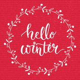 Hello winter text on red knit texture background. Winter season cards, december typography greetings for social media Stock Photo