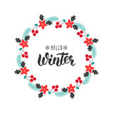 Hello Winter. Trendy handwriting quote with greeting wreath with rowanberry,fir branches, poinsettia for Christmas cards, invitati Stock Photos