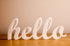 Hello on Wooden Table Stock Photos