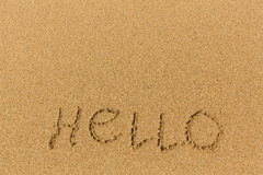 Hello - word drawn on the sand beach. Royalty Free Stock Photo