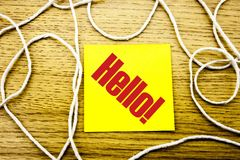 Hello - word on yellow sticky note in wooden background. Bussines concept. royalty free stock photography