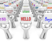 Hello Words Different Languages Greeting World Culture Diversity. People holding signs with Hello word in different languages representing translating messages Royalty Free Stock Images