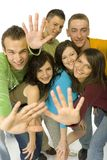 Hello world!. Group of 6 happy teenagers. They're gesture to the camera. Wide angle. White background Stock Photos