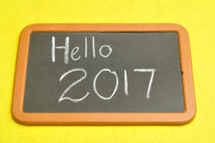 Hello 2017. Written on a blackboard Royalty Free Stock Images