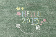Hello 2015 written on wooden board by using chalk Royalty Free Stock Photography